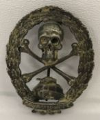 A Spanish Civil War style Austrian Storm Troops Tank Brigade pin back badge.