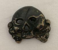 A German WWII style Allgemeine SS Totenkopf skull badge - jawless type.