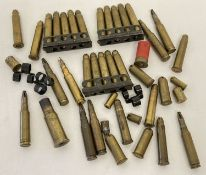 A collection of blank bullets. 21 x .303, 15 housed in No. 4 clips.