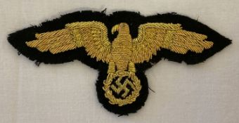 A reproduction WWII style German diplomatic officials gold bullion cap eagle cloth badge.