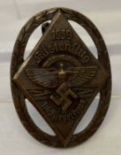 A German WWII style N.S.F.K. competition pin back badge.