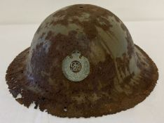 A British WWI semi relic Brodie helmet with Royal Engineers Cap badge fixed to front.