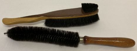 """2 vintage wooden handled uniform brushes, one stamped """"Rooney 1943"""" to handle."""