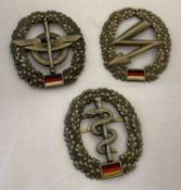 3 modern BRD German army beret badges. Logistics QM troops, Medical troops and Signal Corps.
