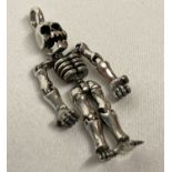 A 925 silver pendant in the form of an articulated skeleton.