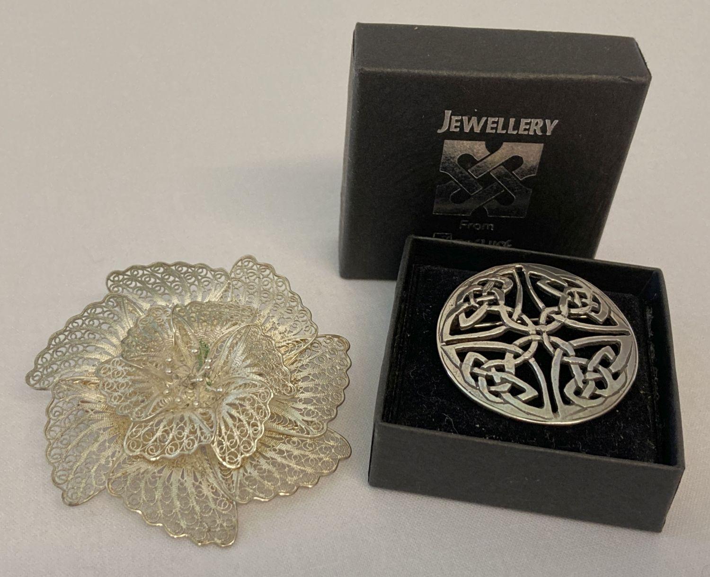 A vintage 925 silver fine filigree flower brooch together with a modern silver Celtic design brooch.