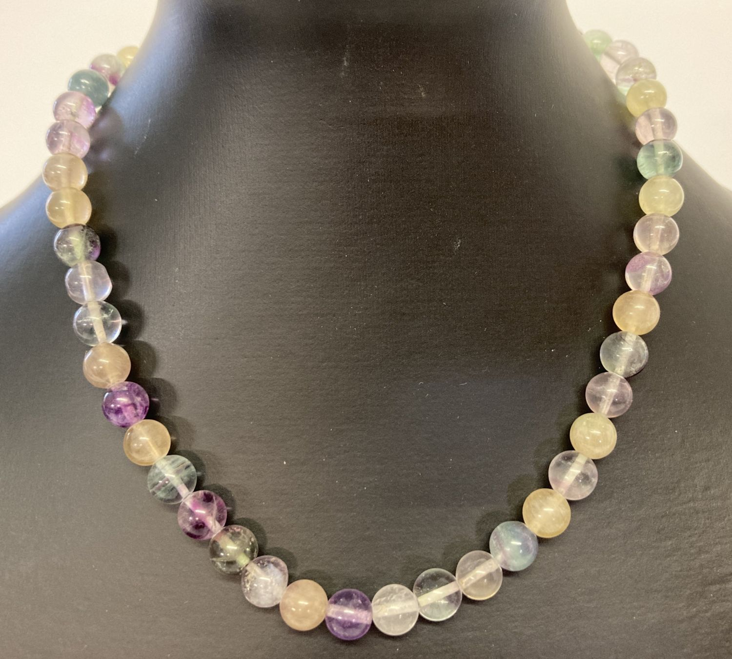A fine, coloured fluorite beaded necklace with silver lobster claw clasp.