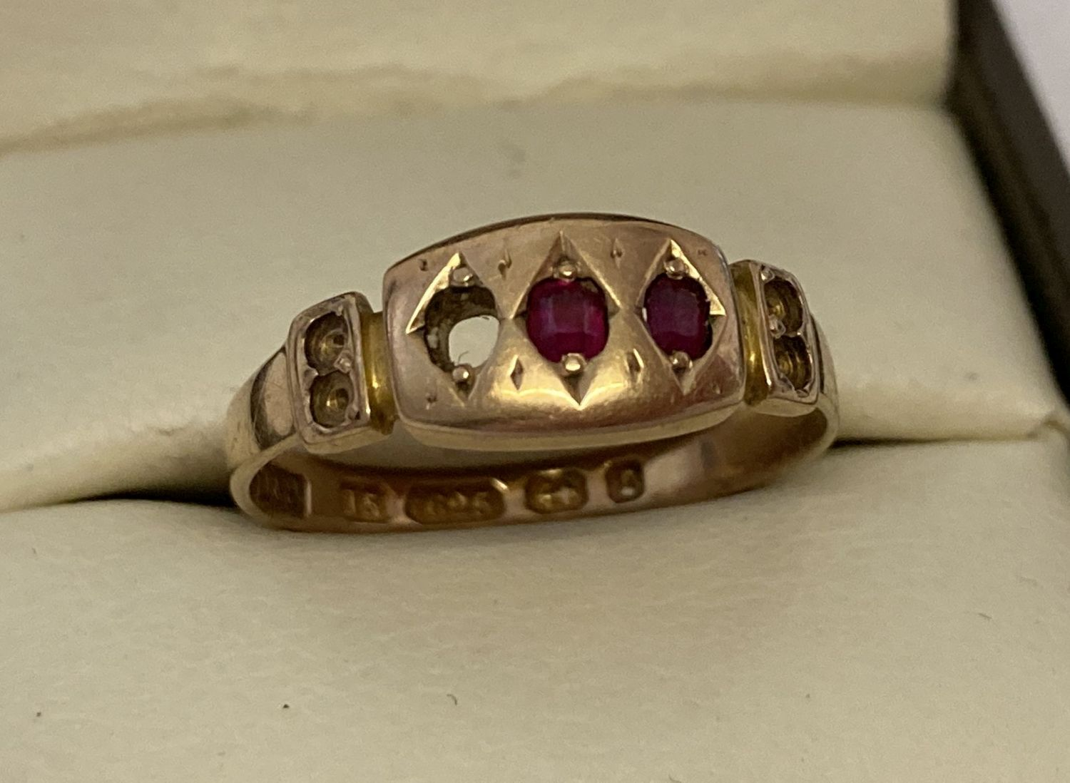 An antique 15ct gold and ruby dress ring, for scrap or repair.