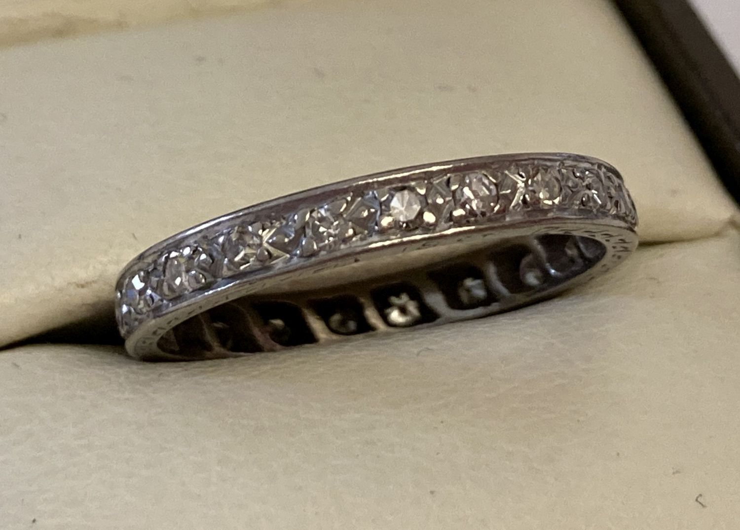 An 18ct white gold full eternity ring set with 20 small round cut diamonds.
