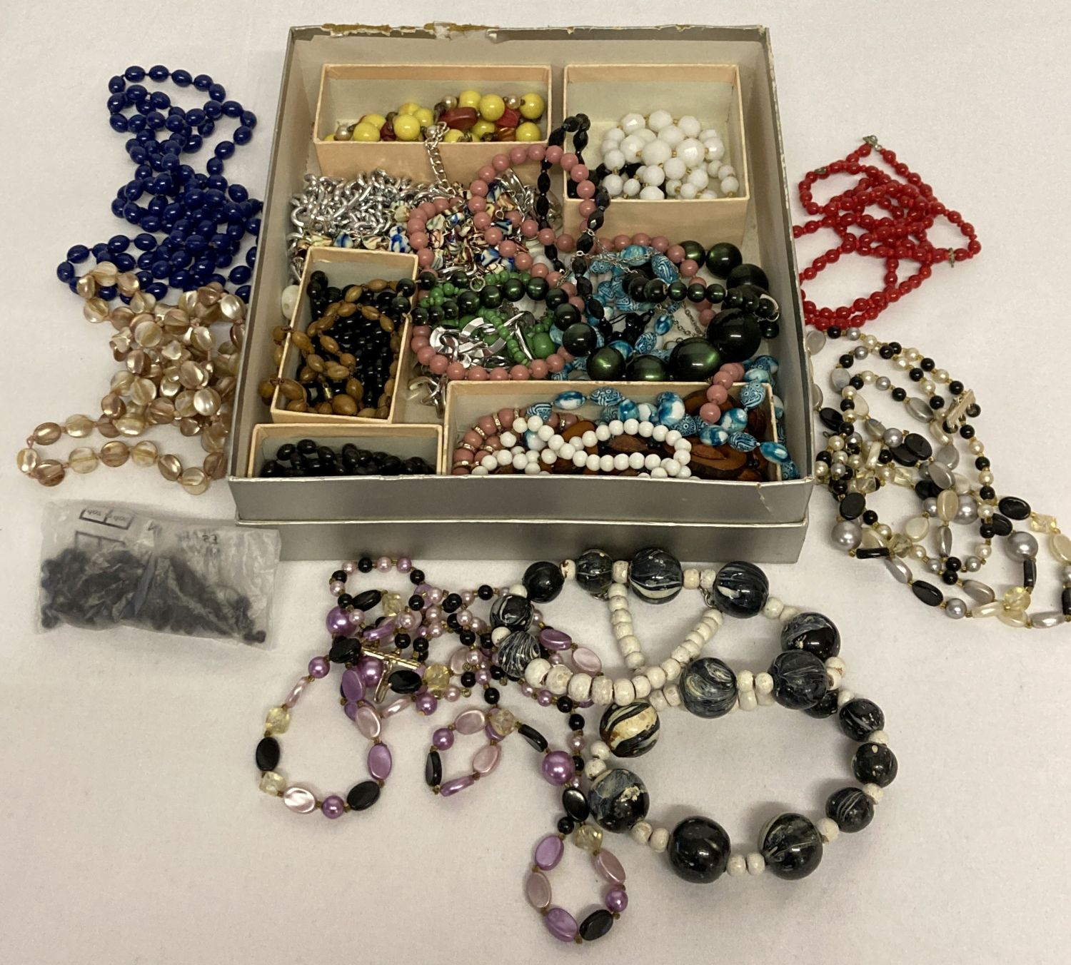 A quantity of assorted vintage beaded necklaces.