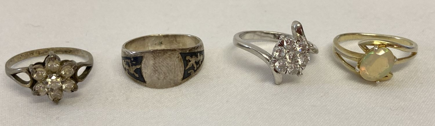 4 silver dress rings, all marked to inside of bands.