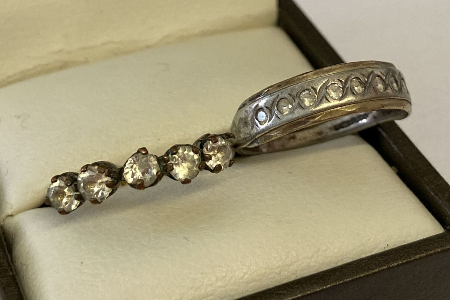 A vintage silver eternity style ring set with 9 small round cut diamonds, ring size M½.