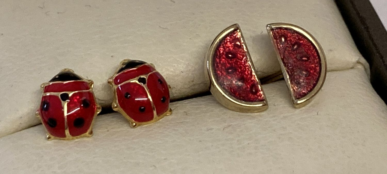 2 pairs of gold stud style earrings with enamel detail.