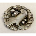 """A vintage Georg Jensen silver bird brooch #165 with """"silver pearl"""" detail."""