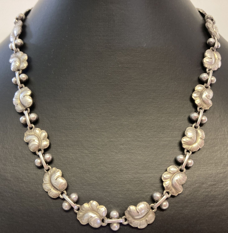 """A vintage Georg Jensen silver 16"""" necklace with leaf link design, #96."""