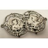 An antique silver Art Nouveau belt buckle, hallmarked B'ham 1900, with pierced work detail.