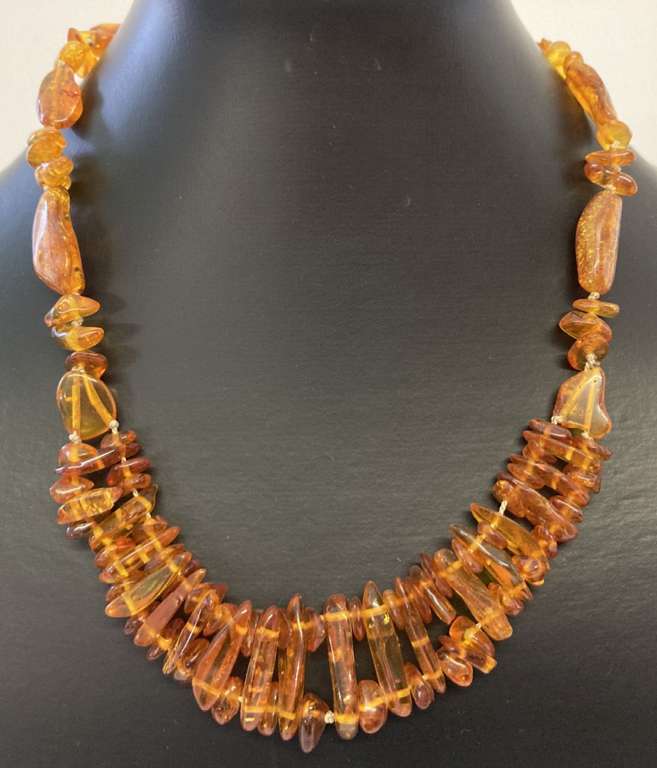An 18 inch amber necklace made from varying sized pieces of amber, with screw barrel clasp.