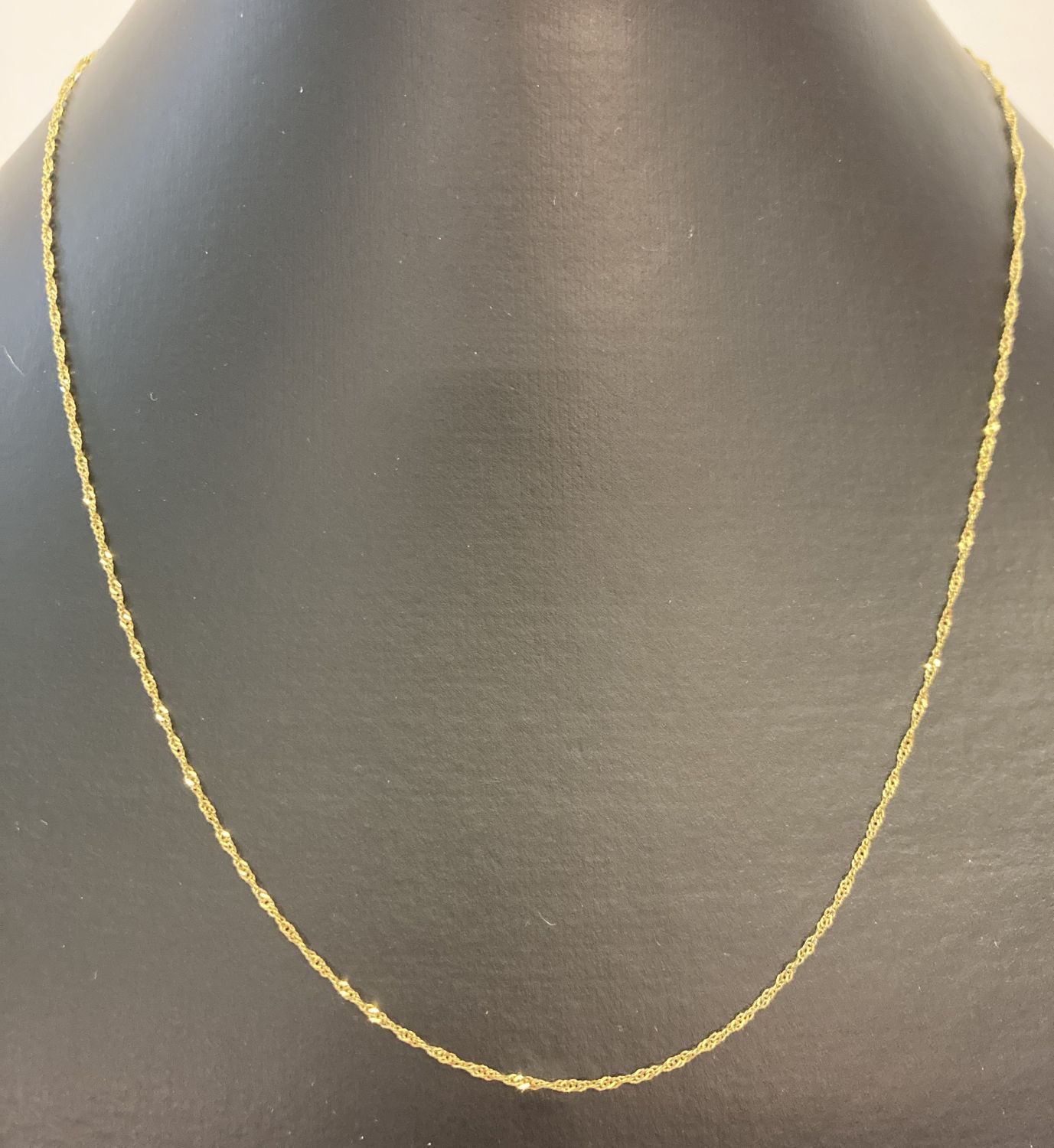 """A 9ct gold 28"""" fine rope chain with spring clasp."""