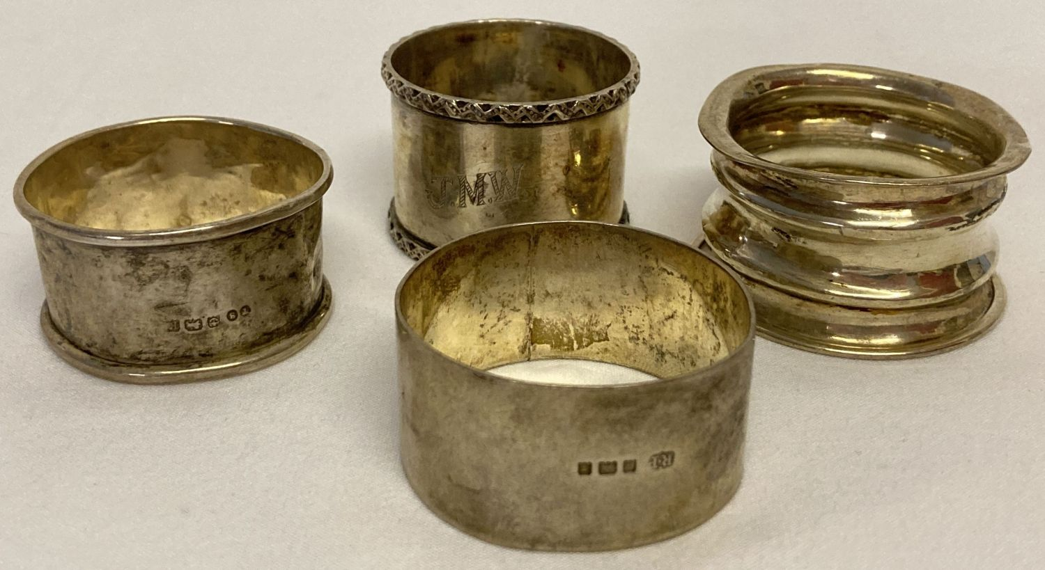 4 vintage hallmarked silver napkin rings, 2 with engraved monograms.