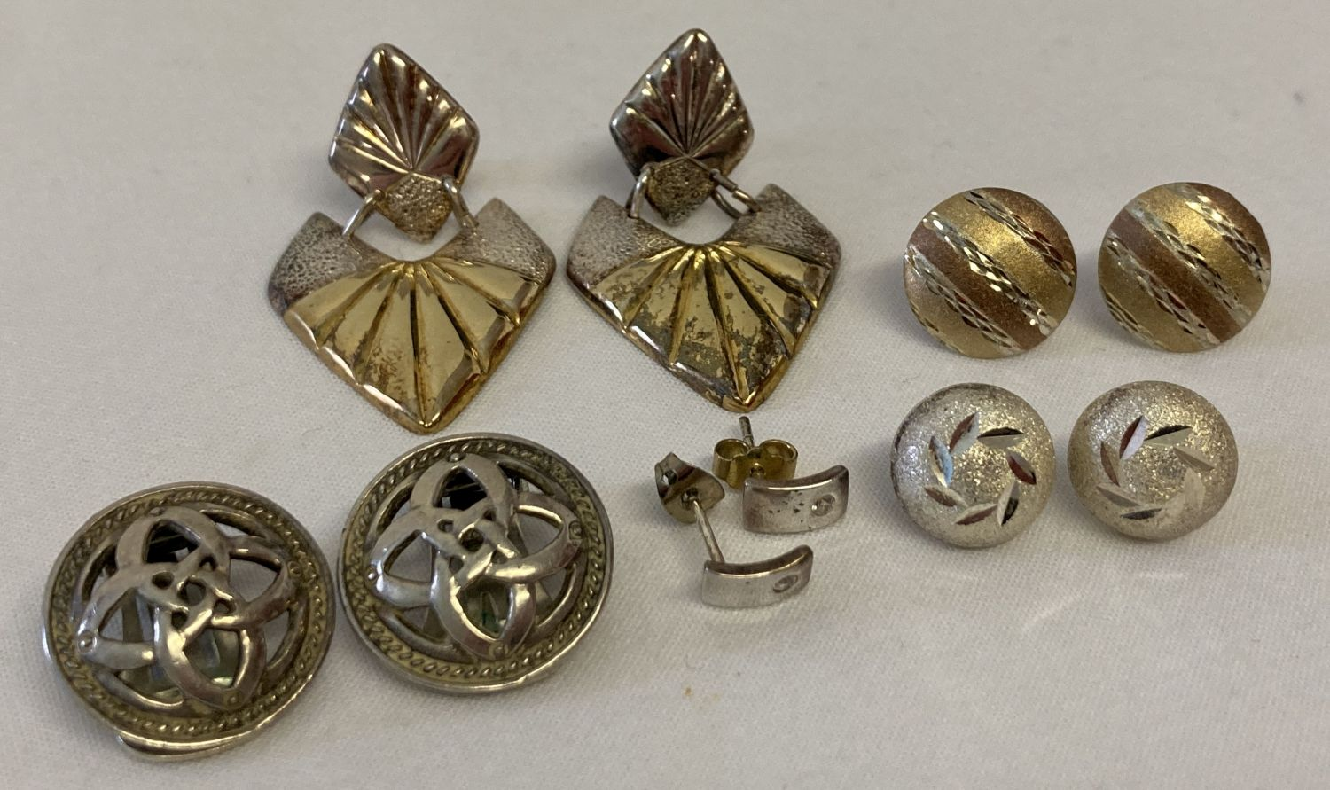 5 pairs of silver and white metal stud, drop and clip on earrings.