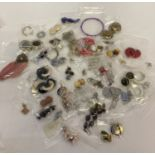 60 pairs of vintage and modern clip on and pierced earrings, in both stud and drop styles.