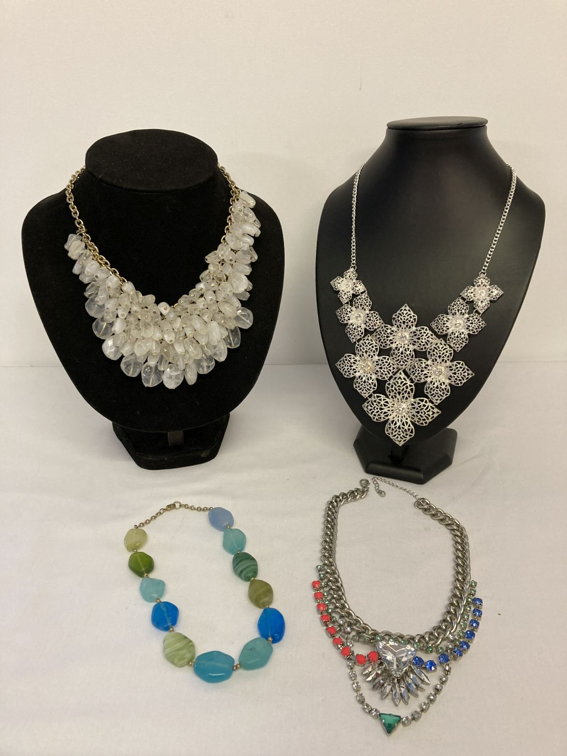 4 modern design costume jewellery statement necklaces in varying designs.