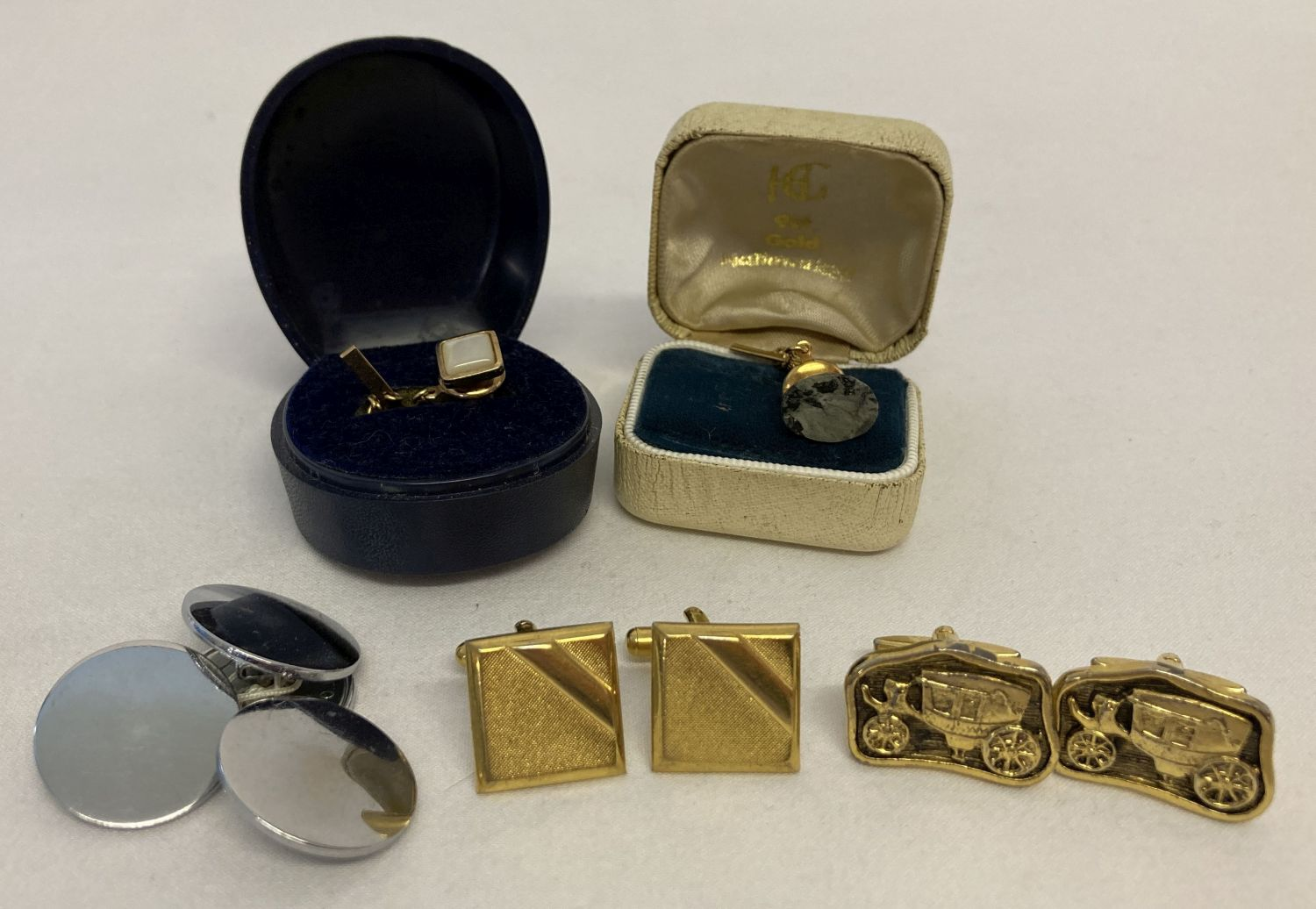 A collection of vintage tie pins and cufflinks to include examples by Huttons and Commodore.