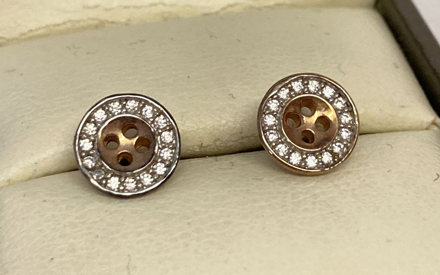 A boxed pair of silver gilt diamond set button earrings by Bouton.