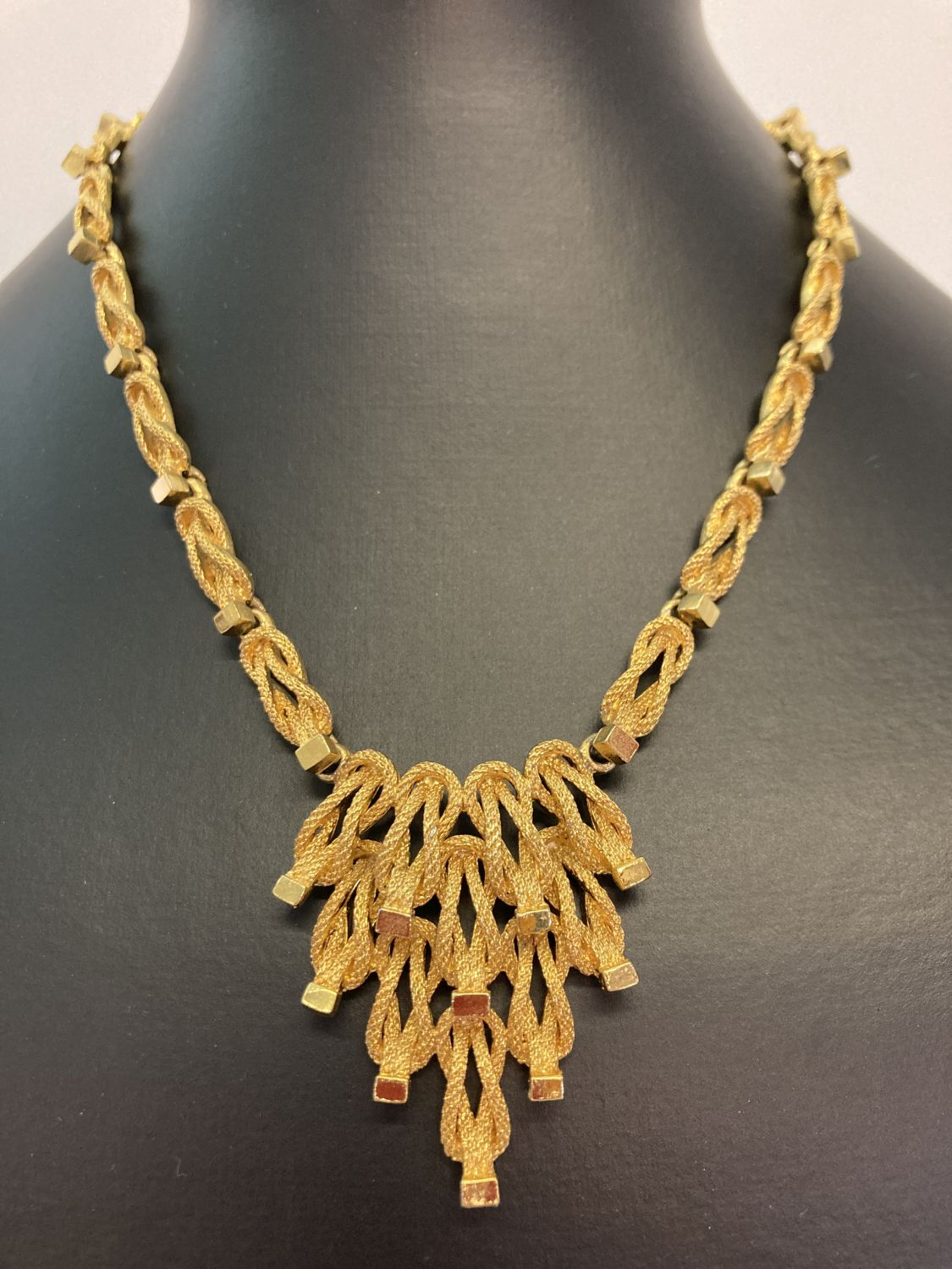 A vintage 1970's gold tone necklace with fixed hanging pendant, Marked to reverse '1594'.