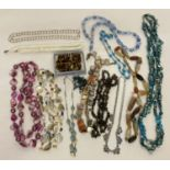 A quantity of vintage shell, natural stone and glass bead necklaces.
