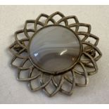 A vintage silver Iona brooch in flower design, set with central white and grey natural agate.