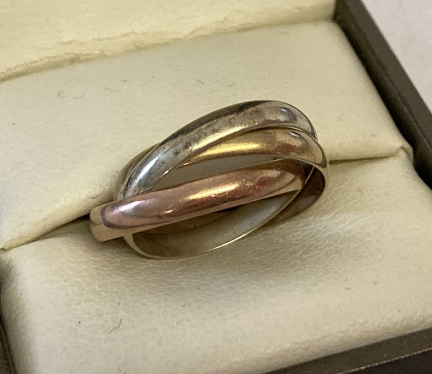 A 9ct gold tri colour gold Russian wedding ring.