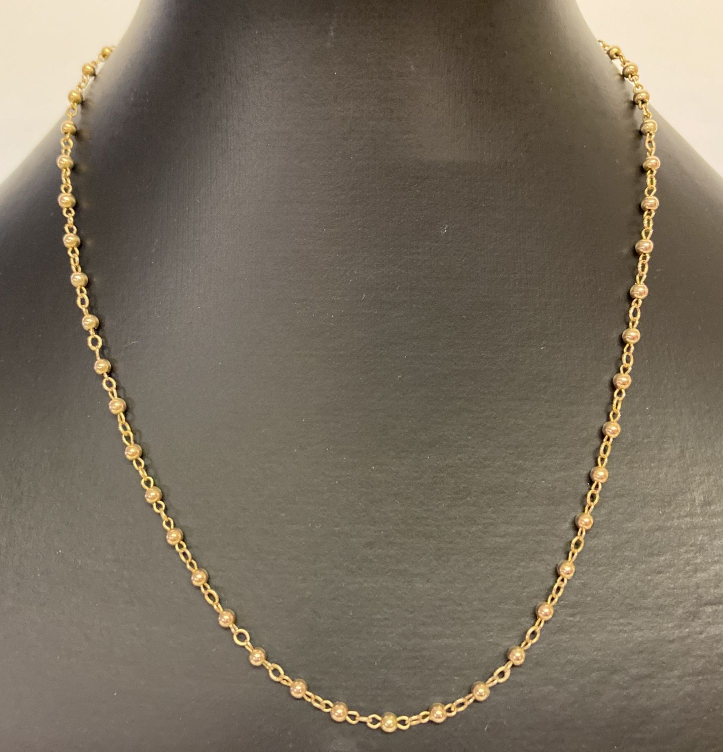 """A vintage 9ct gold 18"""" chain with ball design links."""