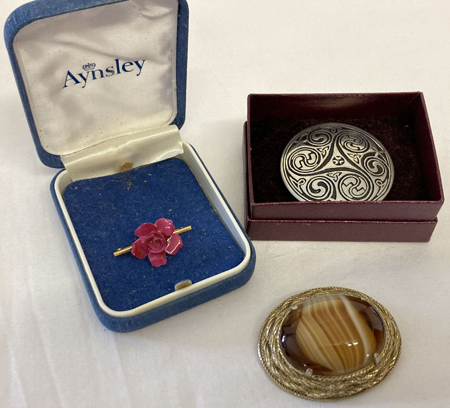 3 vintage brooches. A boxed large circular brooch with Celtic design by St. Justin.