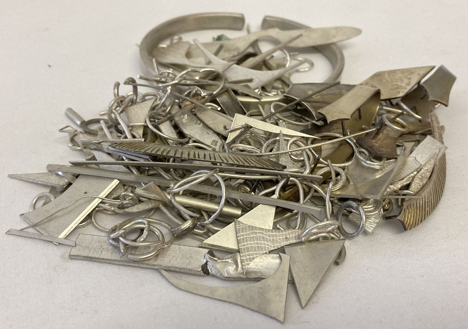 A bag of scrap silver pieces from a jewellery maker.