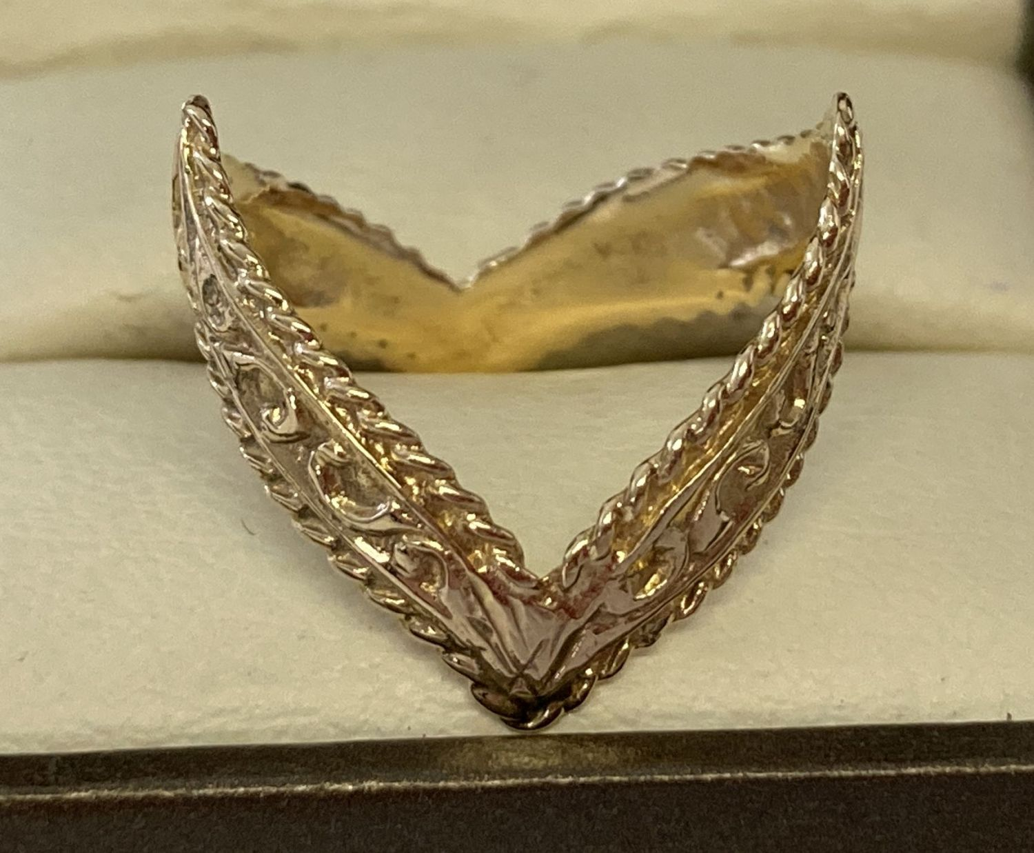 A 9ct gold double wishbone dress ring with scroll decoration throughout.