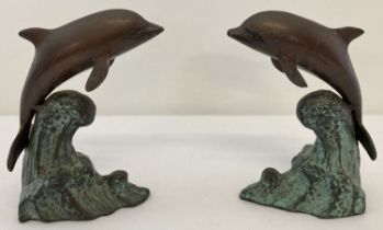 A pair of bronze dolphins, riding a wave, figures/bookends.
