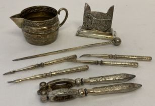 A small quantity of assorted vintage silver plated & pewter items to include nutcrackers.