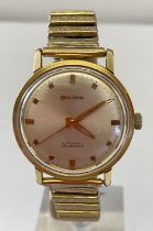 A vintage mens automatic wristwatch by Bulova with expanding bracelet strap.