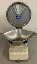 A large set of vintage shop weighing scales complete with metal dish.