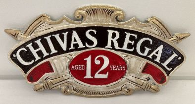 A Chivas Regal Scotch whisky painted cast metal wall hanging plaque.