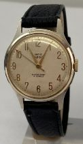 A vintage mens Empire wristwatch by Smiths with black leather strap.