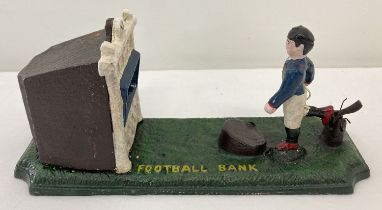 A painted cast metal mechanical Football bank money box.