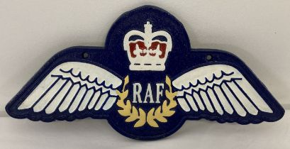 A painted cast iron RAF wings wall plaque with fixing holes.