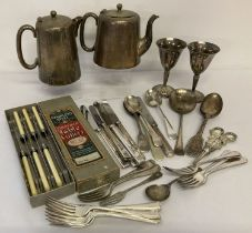 A collection of vintage silver plated cutlery, together with decorative grape scissors and goblets.