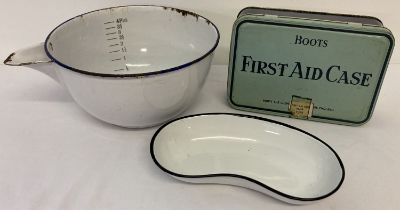 3 items of enamel ware. A mixing bowl with pouring spout and a kidney shaped shallow dish.