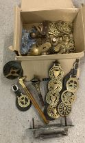 A box of mixed metalware, to include horse brasses, letter box and door handles.