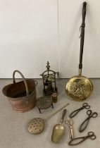A collection of vintage brass, copper and metalware.