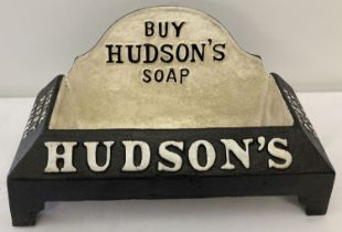 A black and white painted cast iron Hudson's Soap dog drinker.