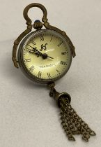 A brass bound ball watch pendant with tassel detail, roman numeral markers & hinged pendant bale.